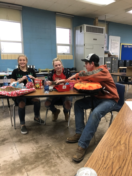 Vayda S, Josie S, and Drake S open their gifts at the FFA Christmas Party today!